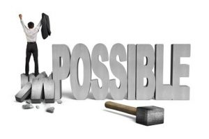 cheering man standing on cracked impossible 3D concrete word with hammer and white background